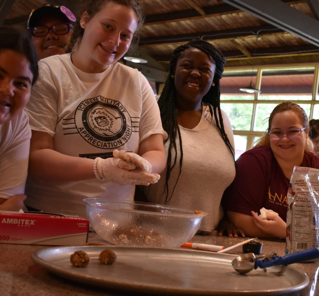 Girls at camp learning about good nutrition; learn more during National Nutrition Month